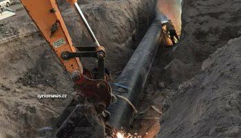 Maintenance teams repairing the Arabian gas pipeline near Deir Ali station blown up by ISIS