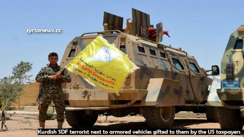 US-sponsored Kurdish SDF terrorist next to armored vehicles gifted to them by US taxpayers