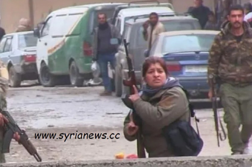 Armed SDF preventing flour delivery to commercial bakeries.