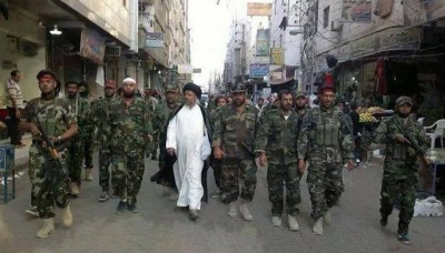 Un chef de milice chiite irakienne inspectant ses troupes à Damas (mai 2014)