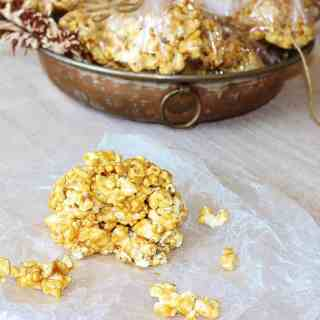 Old Fashioned Popcorn Balls. Freshly popped popcorn balls coated with a butterscotch-y candy coating