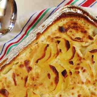 Buttermilk Scalloped Potatoes. Thinly sliced Yukon gold potatoes baked in a white sauce made with buttermilk, sweet onions and garlic.