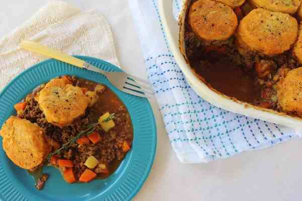 Hamburger Pot Pie with Herb Biscuit Topper. A family friendly meal of ground beef and vegetable filling topped with herb biscuits.