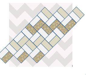 Cheron-quilten består av små kvadrater som sys sammen så de danner et zikkzakk-mønster.