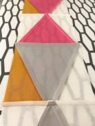 Jeg strøk sømsmonnene fra den store trekanten ut mot de mindre sidetrekantene