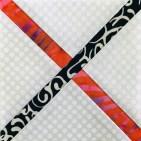 Det sort/hvite batikkstoffet strammet deisgnet opp