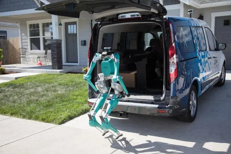 Digit by Agility Robotics, after making the delivery, is preparing to resume its place inside the self-driving Ford van. Source: Ford
