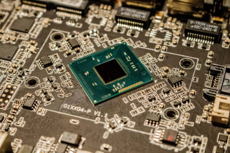 Microchip on electronic board. Smallest microchip in the world.