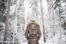 girl-in-winter-jacket-walking-in-snowy-forest-picjumbo-com