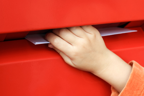 The,Child's,Hand,Throws,A,Letter,Into,The,Mailbox