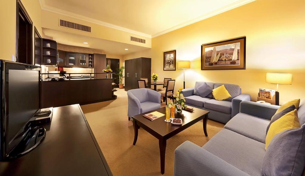 living room restaurant abu dhabi sheer curtains al manzel hotel apts uae booking com gallery image of this property