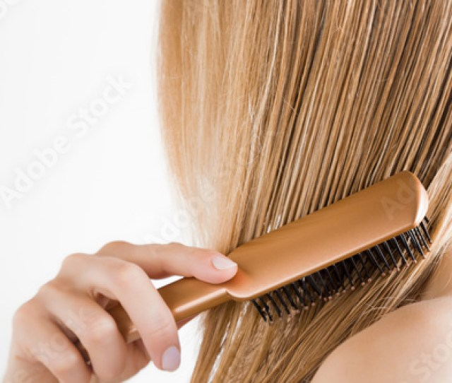 Young Woman With Comb Brushing Her Wet Blonde Perfect Hair After Shower On The