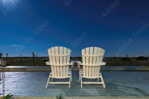 cape cod beach chair klaussner rocking on at night with stars in sky