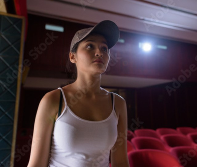 Young Beautiful Asian Woman Inside Movie Theater