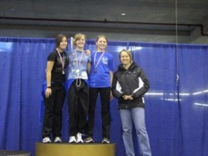 Mallory (left) receiving silver at provincials. 6-time Olympic medallist Cindy Klassen on the far right. 2009.