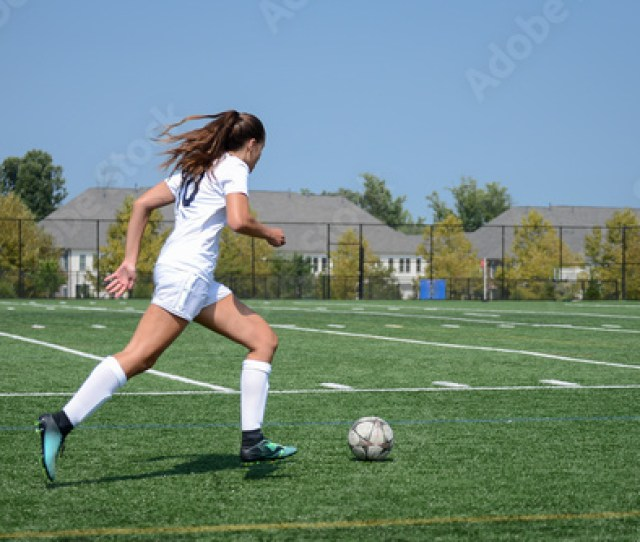 Girl Sprinting Towards The Goal By Herself