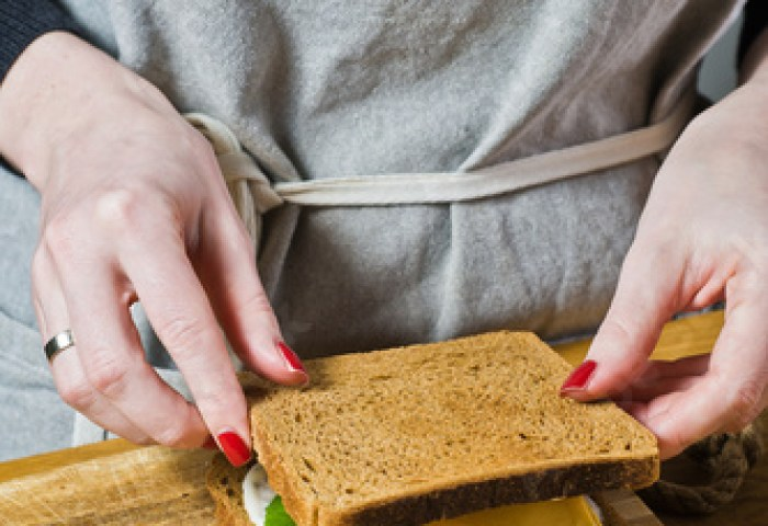 The Chef Prepares A Sandwich With Toast Of Black Bread Black