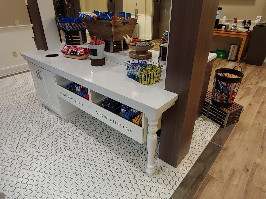 Painted cabinetry & table leg with quartz countertop