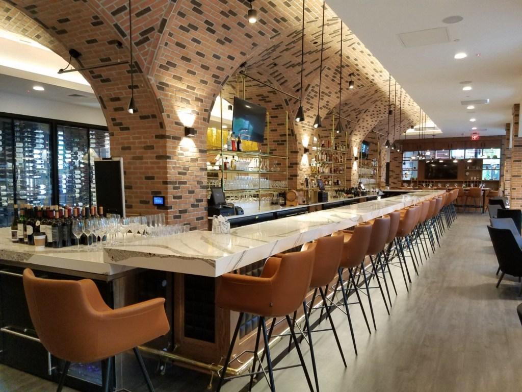 Quartz bar tops & hardwood bar wall