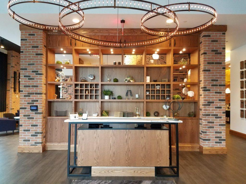 Hardwood  veneer feature wall with steel, veneer, & quartz desk