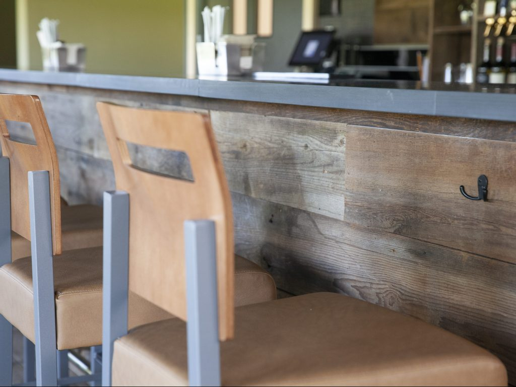 Stone countertop & reclaimed wood bar front