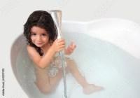 """""""Baby girl is taking shower in the bathtub"""" Stockfotos und ..."""