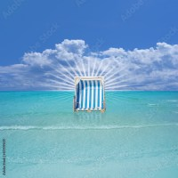 """""""Beach Chair in the Water"""" Stock photo and royalty-free ..."""