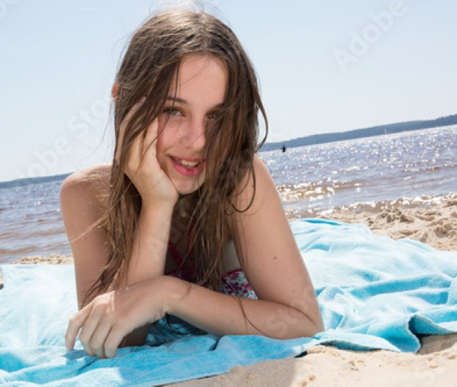 Very Pretty Young Girl On The Beach At Summertime