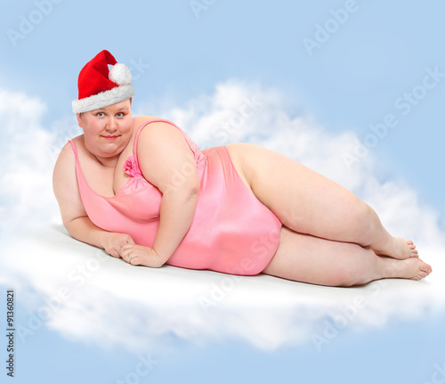 Obese Woman With Santas Cap Flying On Cloud In Heaven