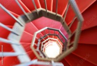 """spiral staircase with moving steps and the red carpet ..."