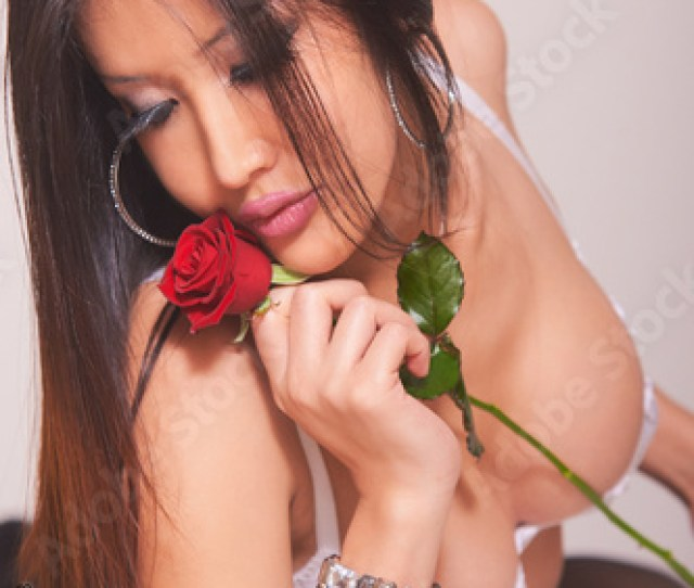 Sensual Portrait Of Mixed Race Oriental Asian Girl Wearing Sensual Sexy White Lingerie Holding Red Rose