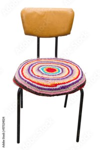 """Old leatherette chair with handmade knit round cover"