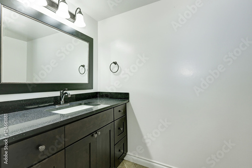 Bathroom vanity in black color in empty apartment Stock photo and royaltyfree images on