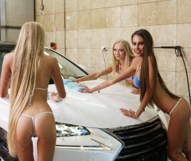 Hot Girls Pose At Camera While Washing Cars Hood