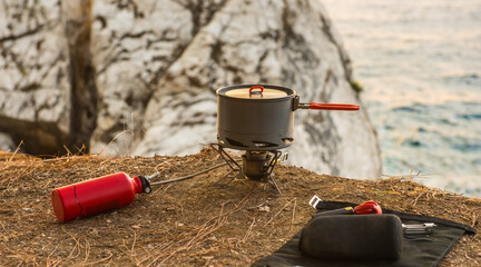 propane tank, connect to a backpacking burner, with pot over.