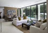 """Florida home living room overlooking pool"" Stock photo ..."