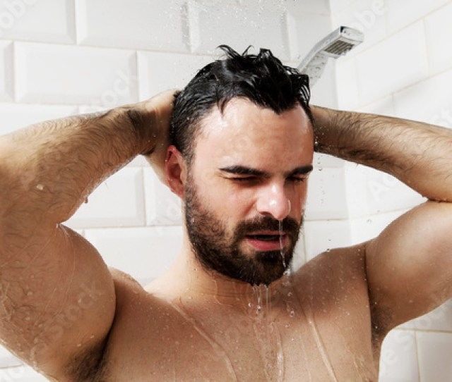 Handsome Naked Young Man Taking Shower In Bathroom