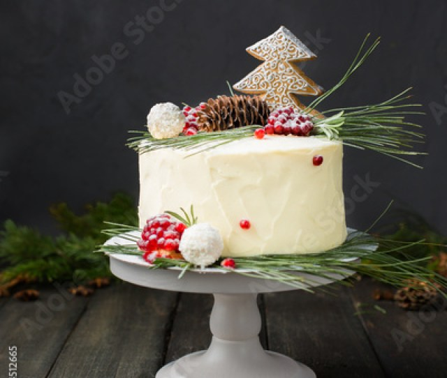 A Beautiful Chocolate Cake With Cheese Cream Coconut And Christmas Decorations On A Dark Wooden