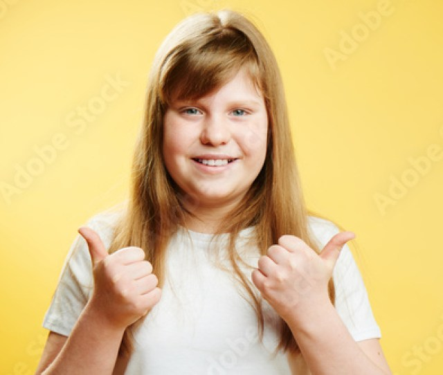 Chubby Redhead Teen Girl Showing Thumbs Up Standing On A Yellow Background