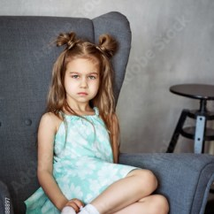Little Girl Chairs Kermit Chair Review Portrait Of Charming Pensive Sitting On Stock