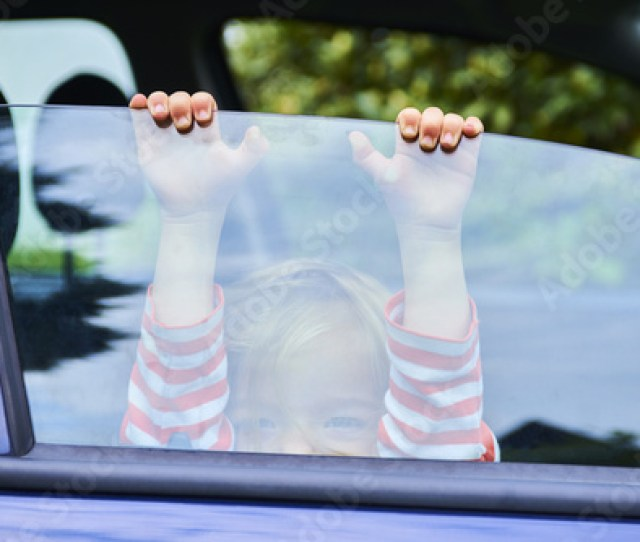 Little Girl Playing Inside Car And Sitting On Front Driver Seat During A Break On A