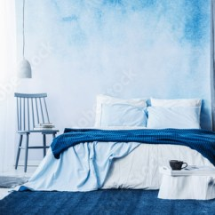 Bedroom Chair With Blanket Bruno Power Lift Parts Navy Blue Carpet In Minimal Interior On Bed Next To A And Under Lamp