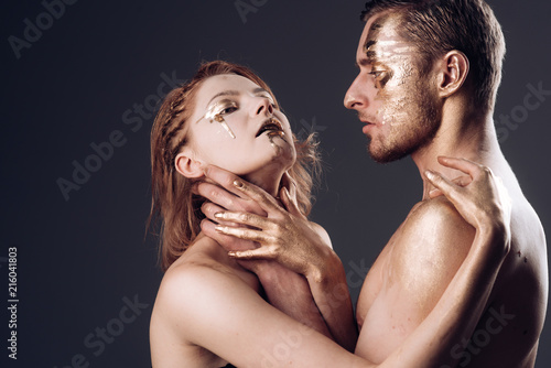 Sensual Couple Having Erotic Games Sensual Couple With Golden Body Embrace