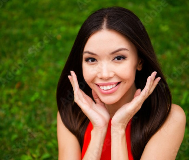 Beautiful And Kind Girl With Luxurious Hair Holds Open Palms Near Her Face Concept Of