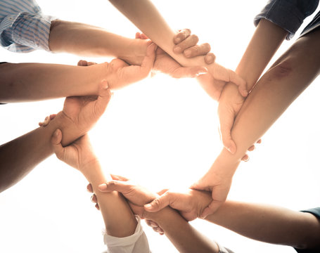 Close up of teamwork holding hands and supporting each other Stock Photo   Adobe Stock