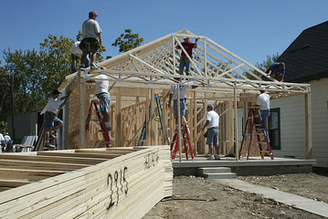 workers framing a house