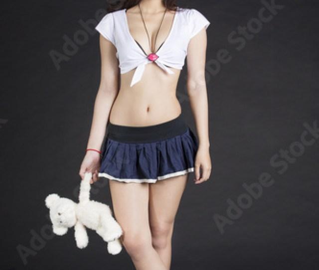 Asian School Girl With Teddy Bear