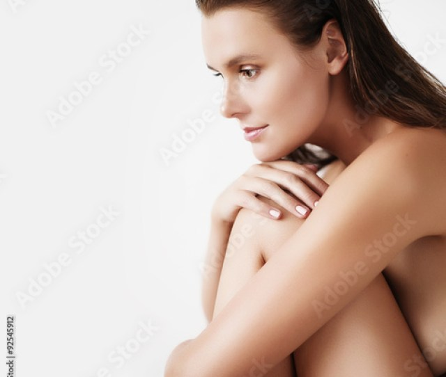 Portrait Of A Beautiful Young Brunette Woman With Smooth Skin Without Clothes Spa Concept