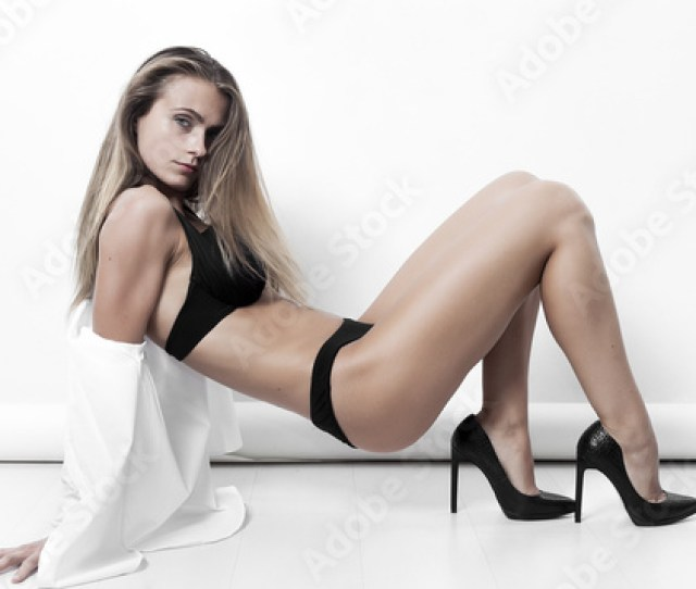 Sexy Woman Wearing Black Lingerie And High Heels Posing