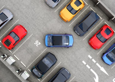 Aerial view of parking lot. Half of parking lot available for EV charging service. 3D rendering image in original design.